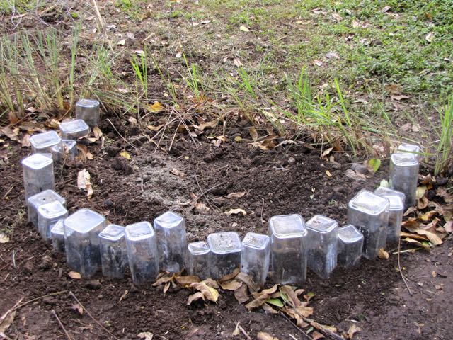 Diy Garden Projects Part - 35: Liquor Bottle Garden Bed