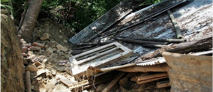 The destroyed livestock shelter at Sunrise Farm.