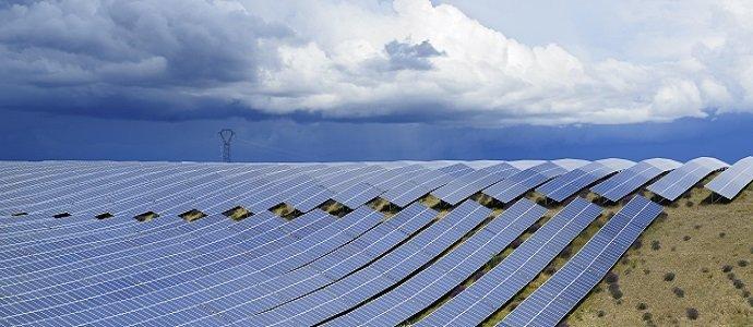 Dark stormy sky above a solar power plant