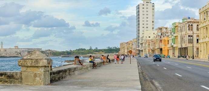 The Malecon in Havana with people and traffic