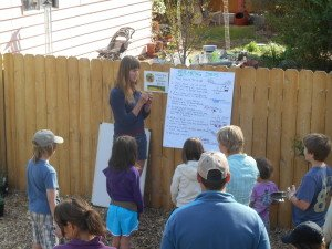 Claire Core teaching children how to plant effectively at the Bee Inspired Garden.