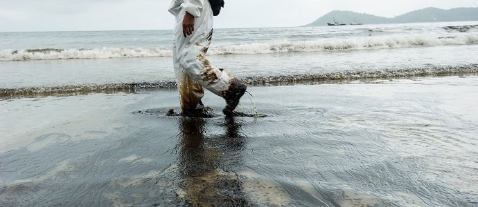crude oil on oil spill accident on Ao Prao Beach at Samet island