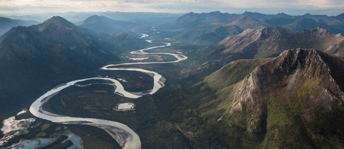 River Winding Through Mountains