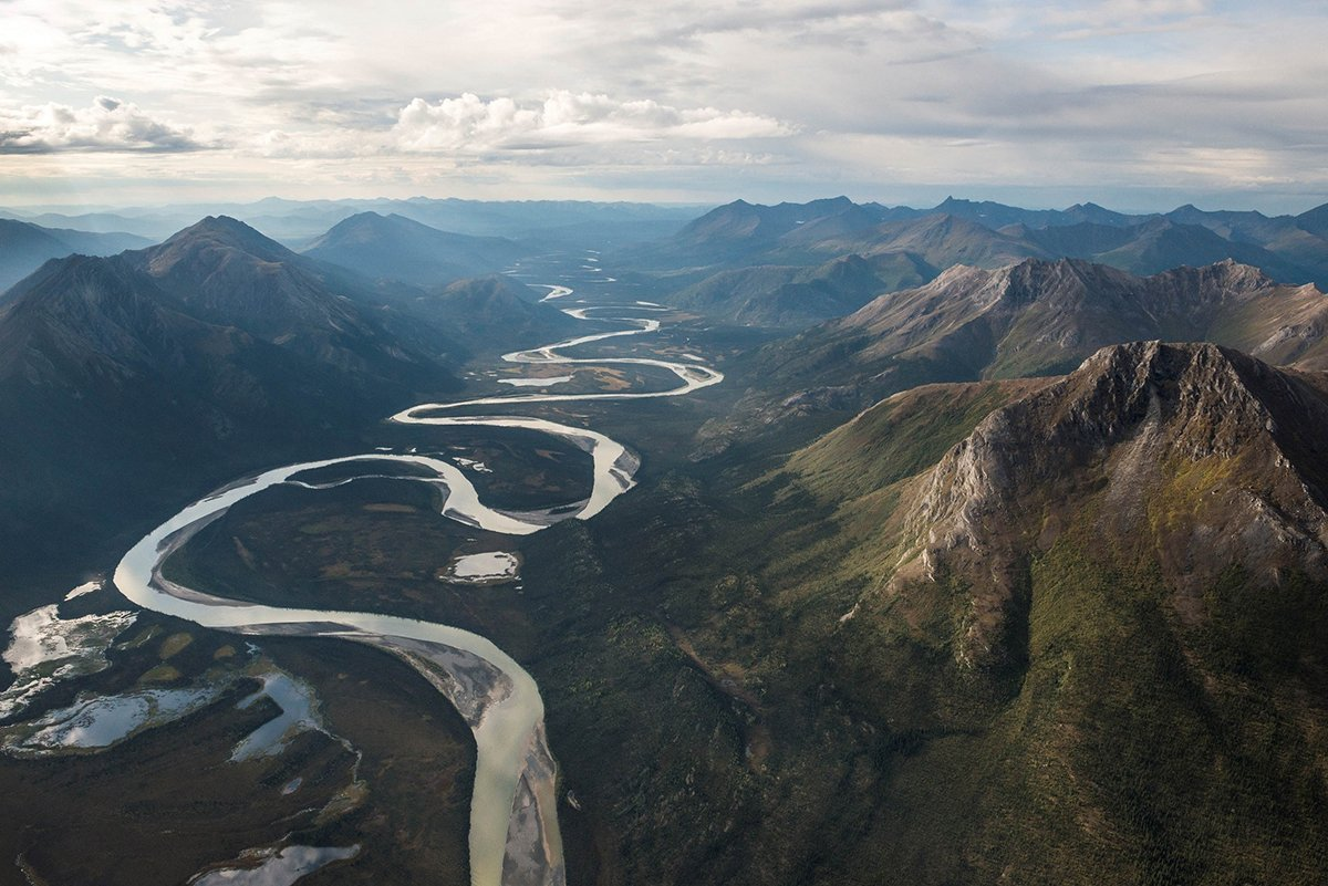 River Winding Through Mountains